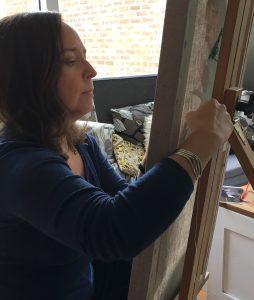 Artist Sheri Gee working on her stitch piece.