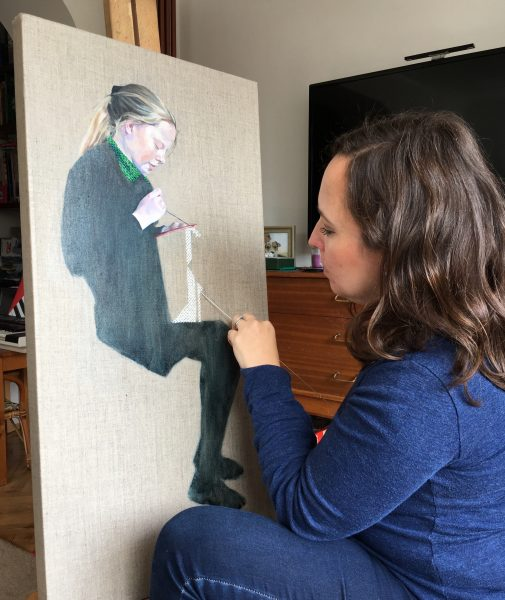 Photo of artist Sheri Gee sewing into her painting
