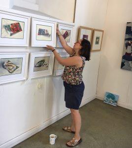 Artist Sheri Gee, shown hanging her work at the Oxmarket Gallery, Chichester
