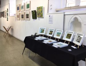 photo of gallery walls, showing artwork hung, from artists from Example art group, East Grinstead